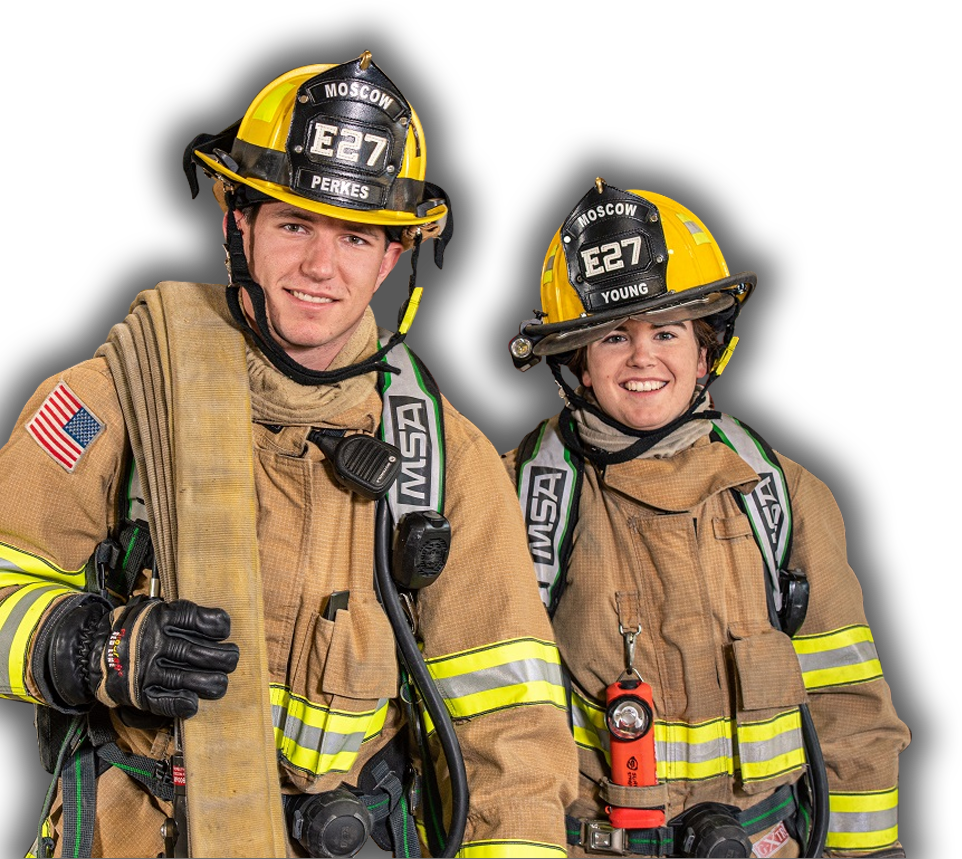 Male And Female Firefighter Standing In Gear